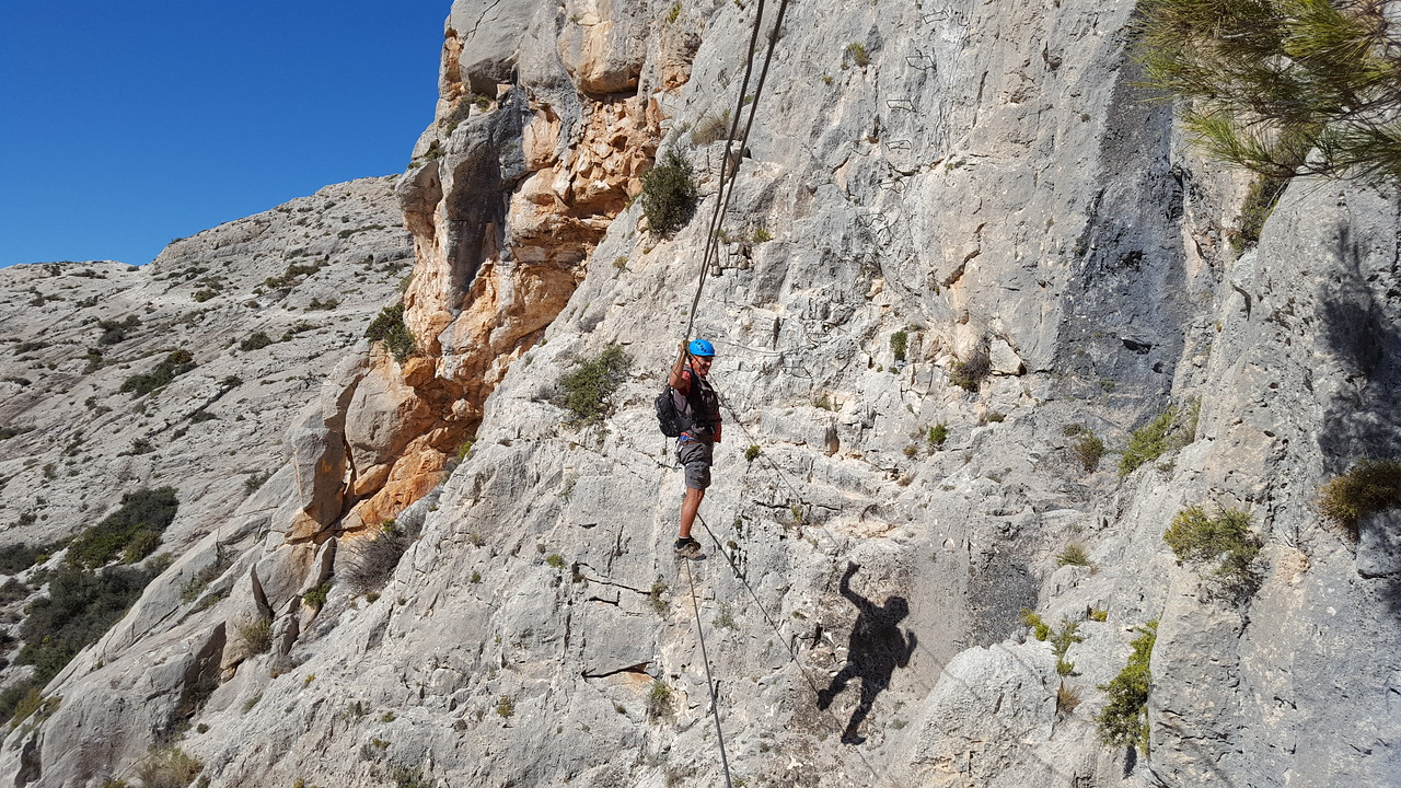 Alfred wobbling on the Via Ferrata Tibetan wire at Castillo de Salvatierra