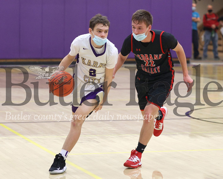 Karns City's Taite Beighley drives down the court against Redbank Valley's Ty Sherry in Tuesday's 74-45 home win. Seb Foltz/Butler Eagle 02/09/21