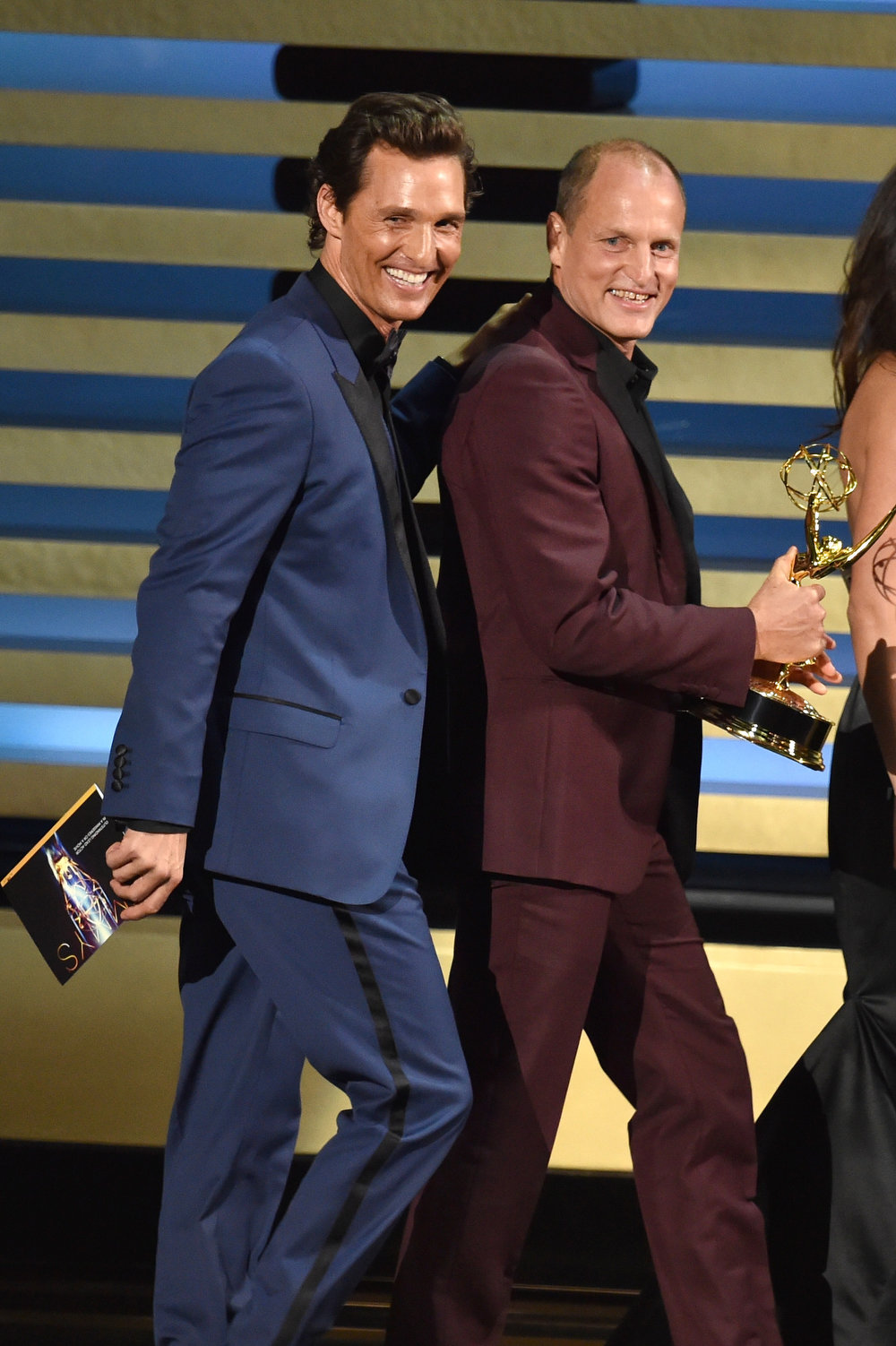 . Actors Matthew McConaughey (L) and Woody Harrelson walk onstage at the 66th Annual Primetime Emmy Awards held at Nokia Theatre L.A. Live on August 25, 2014 in Los Angeles, California.  (Photo by Kevin Winter/Getty Images)