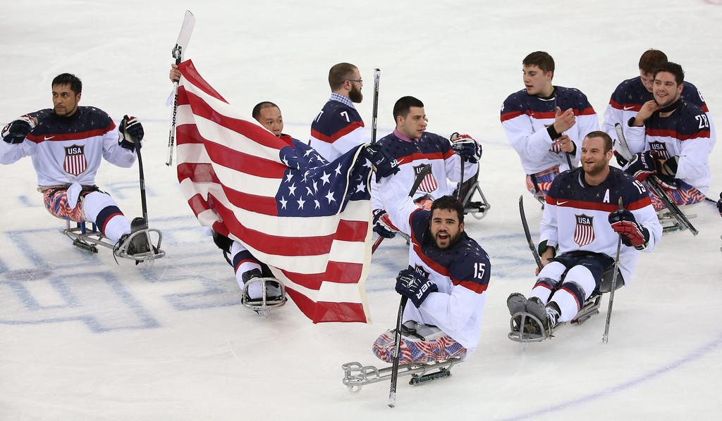 . US national team players celebrate their victory after the Ice Sledge Hockey final match Russia vs USA at Sochi 2014 Paralympic Games, Russia, 15 March 2014.  EPA/SERGEI CHIRIKOV