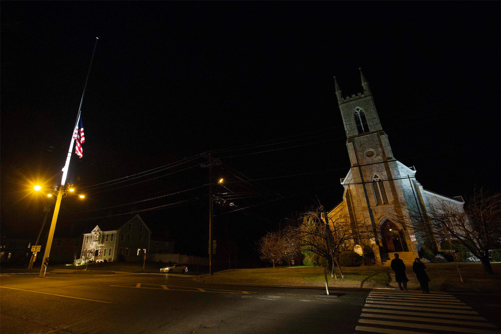 . Residents leave a church following a prayer vigil at a church in Newtown, Connecticut after an earlier shooting at nearby Sandy Hook Elementary School, December 14, 2012. The peace and security of the suburban Connecticut community of Newtown lay shattered on Friday after a gunman attacked a primary school in one of the worst mass shootings in U.S. History. Tearful parents and children gathered around Sandy Hook Elementary School by midday on Friday, surrounded by police vehicles, as young and old alike struggled to make sense of a shooting rampage that killed at least 28 people, including 20 children.  REUTERS/Lucas Jackson