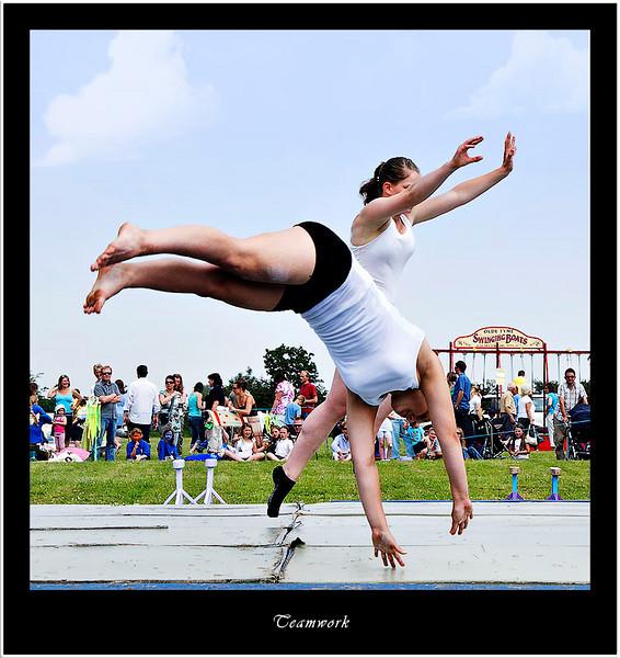 Gymnastic teamwork in action (80569037).jpg