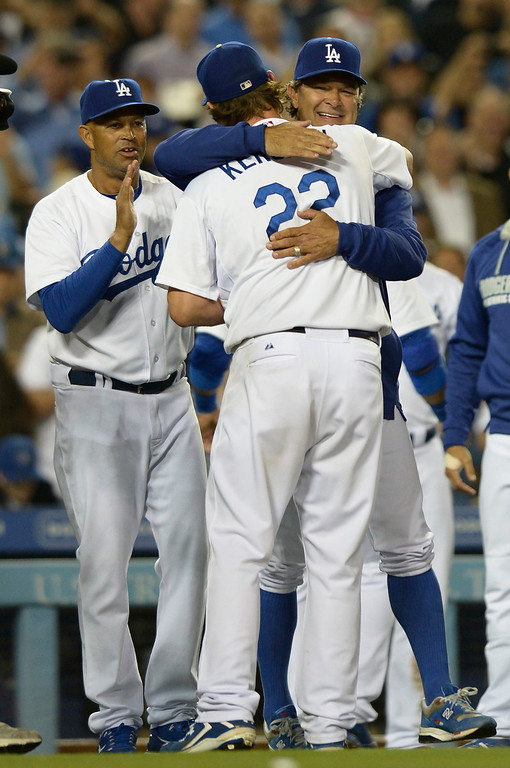 . Dodger Manager Don Mattingly hugs Clayton Kershaw after he threw a no hitter. The Dodgers defeated the Colorado Rockies 8-0 at Dodger Stadium in Los Angeles, CA. 6/18/2014(Photo by John McCoy Daily News)