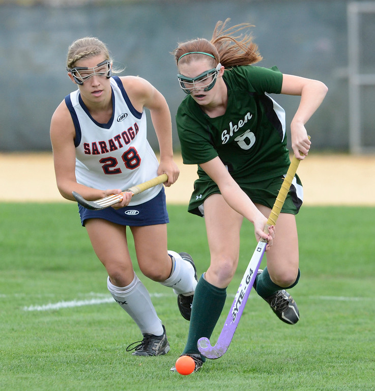 . Shen\'s Molly Hagen works to stay ahead of Saratoga defender Kelsey Briddell during Wednesday\'s varsity field hockey game at Saratoga. Ed Burke -  The Saratogian 10/16/13