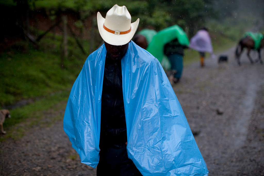 """. In this July 23, 2011, file photo, a villager walks in the rain in the municipality of Nebaj, Guatemala. Guatemalan soldiers allegedly killed villagers during 1982 raids on communities in the municipality of Nebaj.  Twenty-nine years later, in June 2011, the Public Ministry brought charges against Gen. Hector Mario Lopez Fuentes in connection with the planning and ordering of bloody military operations that were part of a military plan coined \""""Victoria 82,\"""" among other crimes during his time as the Defense Ministry\'s Chief of Staff, including the extermination of residents in villages within the municipality of Nebaj during the government of Efrain Rios Montt (1982-1983). (AP Photo/Rodrigo Abd, file)"""