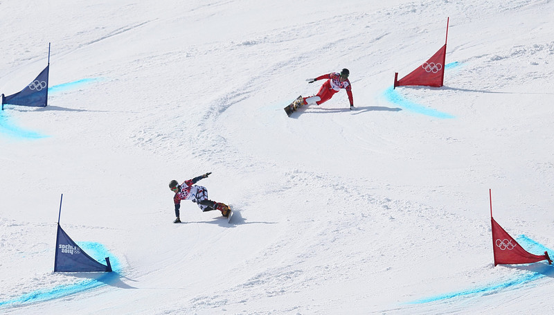 . Vic Wild (L) of Russia competes against Simon Schoch of Switzerland in the quarter final of the men\'s Snowboard Parallel Giant Slalom at Rosa Khutor Extreme Park at the Sochi 2014 Olympic Games, Krasnaya Polyana, Russia, 19 February 2014.  EPA/SERGEY ILNITSKY