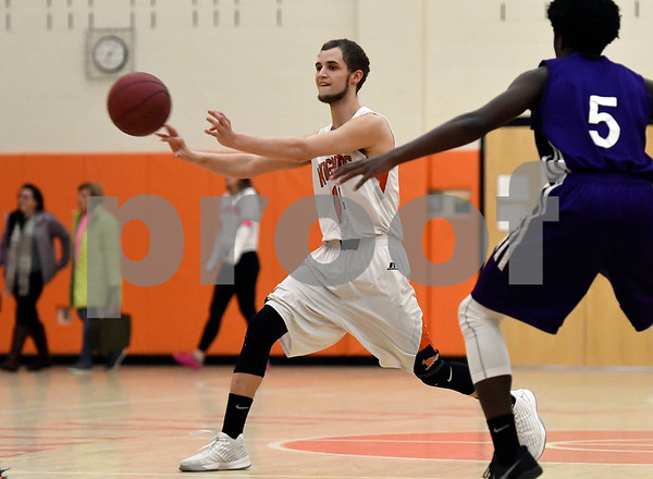 1/10/2018 Mike Orazzi | Staff Terryville High School's Shawn Iwanow (14) during Wednesday night's boys basketball game with Achievement First At Terryville High School.