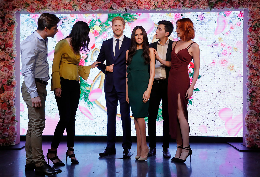 . Visitors look at Britain\'s Prince Harry and his fiancee Meghan Markle who are on display as wax figures at Madame Tussauds in London, Wednesday, May 9, 2018. As the world eyes are on the upcoming royal wedding, Madame Tussauds London unveils Meghan Markle\'s figure, standing alongside a re-styled figure of her groom, Prince Harry. (AP Photo/Frank Augstein)