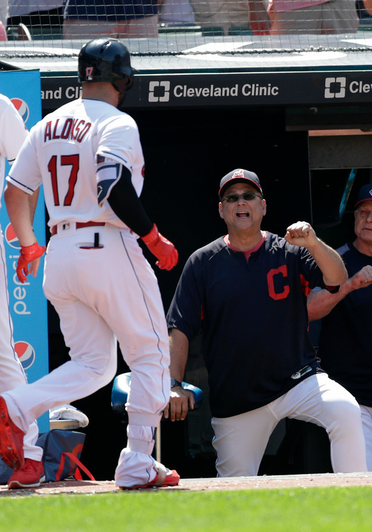 . Cleveland Indians manager Terry Francona, right, congratulates Yonder Alonso after Alonso hit a two-run home run in the eighth inning of a baseball game, Wednesday, July 25, 2018, in Cleveland. (AP Photo/Tony Dejak)