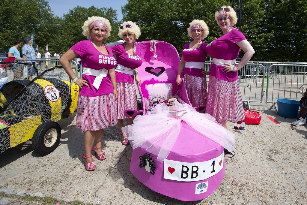 . A team poses with their vehicle in the pit area before competing in the Red Bull Soapbox race in London on July 14, 2013. The Red Bull Soapbox race is an annual event where amateur drivers race with their homemade soapbox vehicles down a 420m hill through obstacles.   JUSTIN TALLIS/AFP/Getty Images