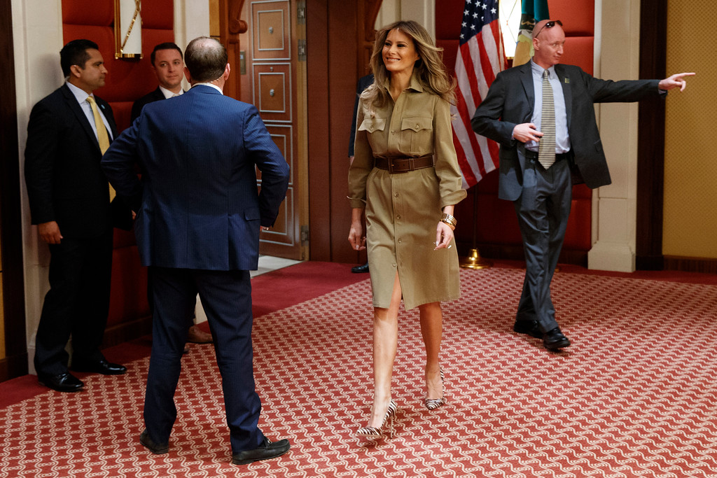 . FIle - In this Sunday, May 21, 2017 file photo, first lady Melania Trump walks in a hallway before a meeting between U.S. President Donald Trump and Bahrain\'s King Hamad bin Isa Al Khalifa, in Riyadh. Trump wore a steady wardrobe of mostly black during President Donald Trump\'s overseas tour, including a prim black lace dress with a matching mantilla headcover that she wore to meet Pope Francis and a dark jacket with golden detailing on the cuff and collar that she wore for her arrival in Italy, both by Milan designers Domenico Dolce and Stefano Gabbana. (AP Photo/Evan Vucci, File)