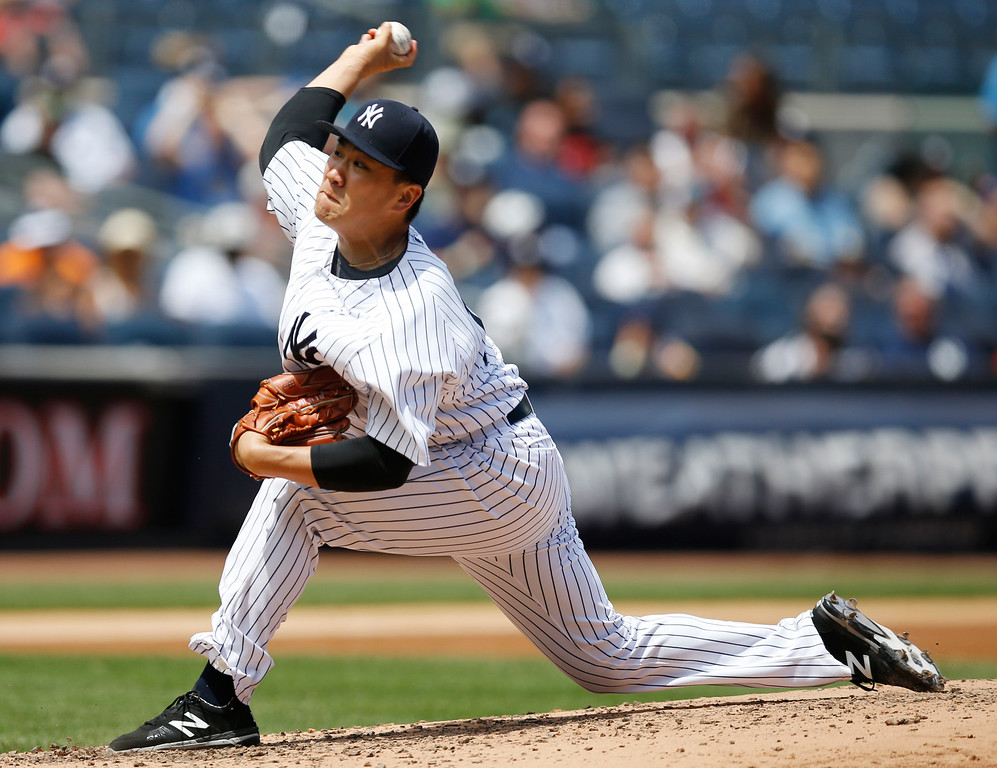 . New York Yankees starting pitcher Masahiro Tanaka delivers in the third inning of a baseball game against the Detroit Tigers at Yankee Stadium in New York, Sunday, June 21, 2015. (AP Photo/Kathy Willens)