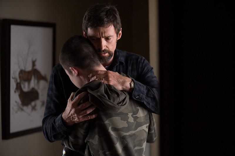 . Hugh Jackman as Keller Dover and Dylan Minnette as Ralph Dover in \'Prisoners.\' (Wilson Webb/Warner Bros. Pictures)