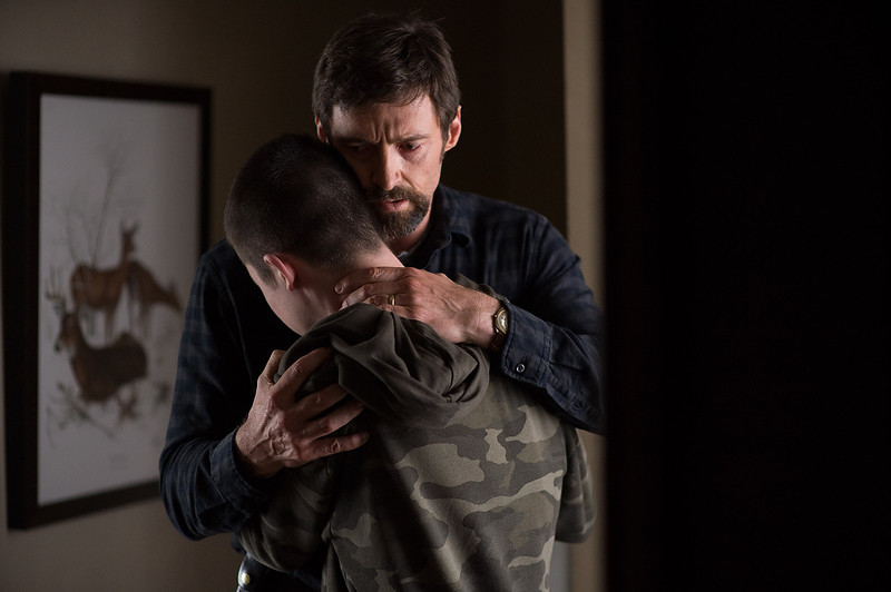 Description of . Hugh Jackman as Keller Dover and Dylan Minnette as Ralph Dover in 'Prisoners.' (Wilson Webb/Warner Bros. Pictures)