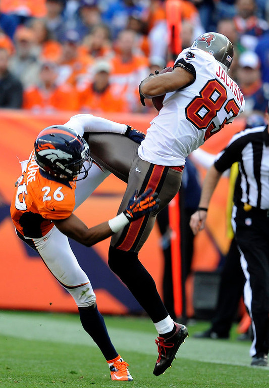 . Tampa Bay Buccaneers wide receiver Vincent Jackson #83 makes a catch over Denver Broncos free safety Rahim Moore #26 during the second quarter. The Denver Broncos vs The Tampa Bay Buccaneers at Sports Authority Field Sunday December 2, 2012. Tim Rasmussen, The Denver Post