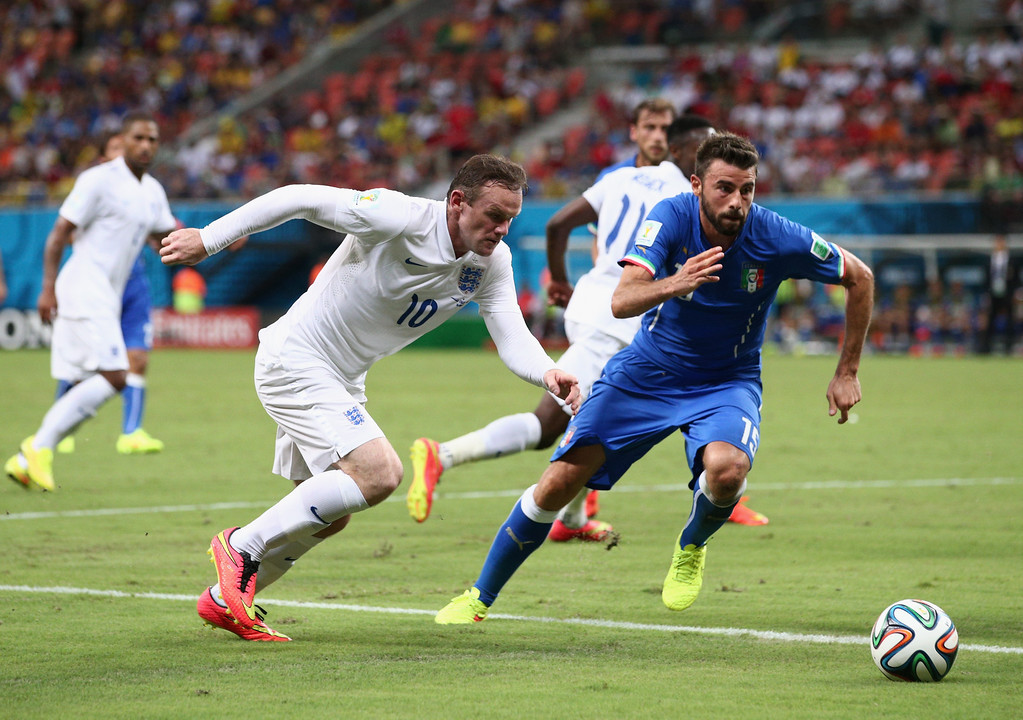 . Wayne Rooney of England controls the ball against Andrea Barzagli of Italy during the 2014 FIFA World Cup Brazil Group D match between England and Italy at Arena Amazonia on June 14, 2014 in Manaus, Brazil.  (Photo by Adam Pretty/Getty Images)
