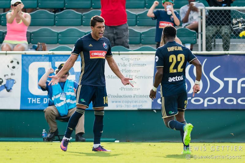 North Carolina FC forward Daniel Rios (14) celebrates his goal with North Carolina FC midfielder Tiyi Shipalane (22)