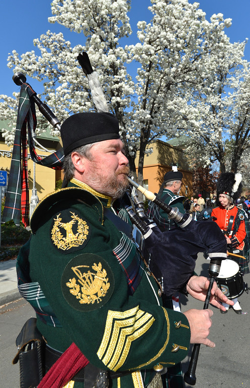 . Ellison Dunlap, of the Piedmont Highlanders, blows his bagpipes during the Saint Patrick\'s Day Parade in Dublin, Calif., on Saturday, March 16, 2013. (Dan Rosenstrauch/Staff)
