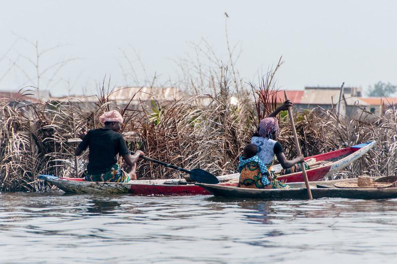 Women on boat in Cotonou, Benin