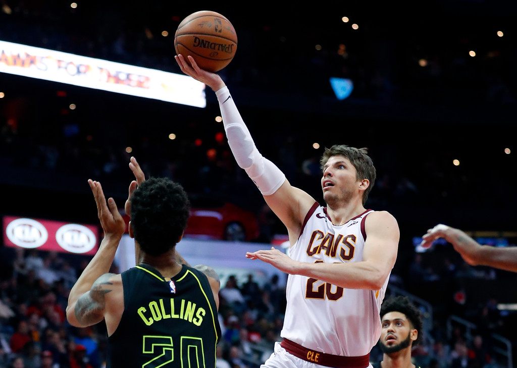 . Cleveland Cavaliers guard Kyle Korver (26) shoots in front of Atlanta Hawks forward John Collins (20) during the second half of an NBA basketball game Friday, Feb. 9, 2018, in Atlanta. Cleveland won 123-107. (AP Photo/John Bazemore)