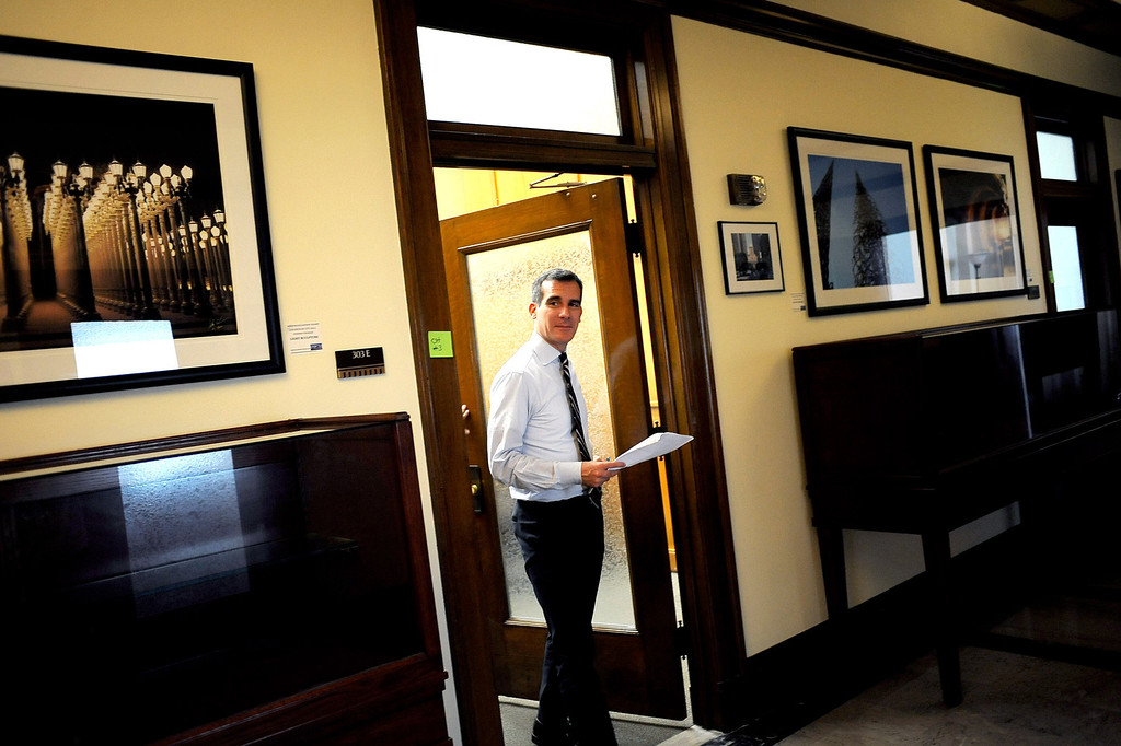 . Mayor Eric Garcetti makes his way to meet with another constituent Monday during his first day as Mayor of Los Angeles.   Garcetti held �office hours� at City Hall from 2-5 p.m., during which he met with Angelenos who have emailed requests for help from City Hall July 1, 2013.(Andy Holzman/Los Angeles Daily News)