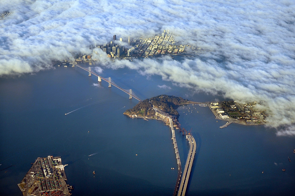 . Getting to fog-shrouded San Francisco--as seen in this Sunday morning Sept. 6, 2009 view-- may become a major headache for Tuesday morning commuters. Caltrans announced Saturday night, the discovery of a crack on an integral i-bar piece of the cantilever section of the San Francisco Oakland Bay Bridge.  The scheduled reopening of the bridge for 5 AM Tuesday is not in doubt.  (Karl Mondon/Staff)