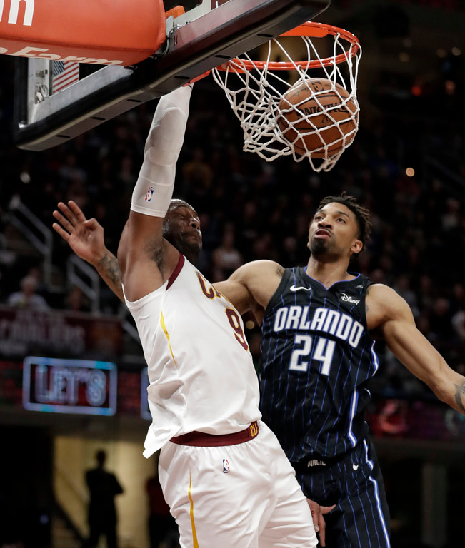 . Cleveland Cavaliers\' Dwyane Wade dunks the ball against Orlando Magic\'s Khem Birch (24) in the first half of an NBA basketball game, Thursday, Jan. 18, 2018, in Cleveland. (AP Photo/Tony Dejak)