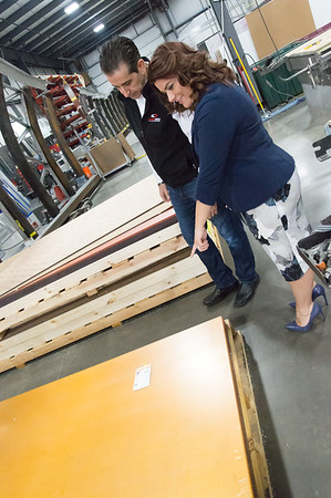 02/15/19 Wesley Bunnell | Staff Sign Pro President Peter Rappoccio and Mayor Erin Stewart examine the different colored plexiglass trim pieces for the Beehive Bridge that Sign Pro is building at its Southington location. The Mayor, along with other city employees, toured Sign Pro on Friday for progress updates.