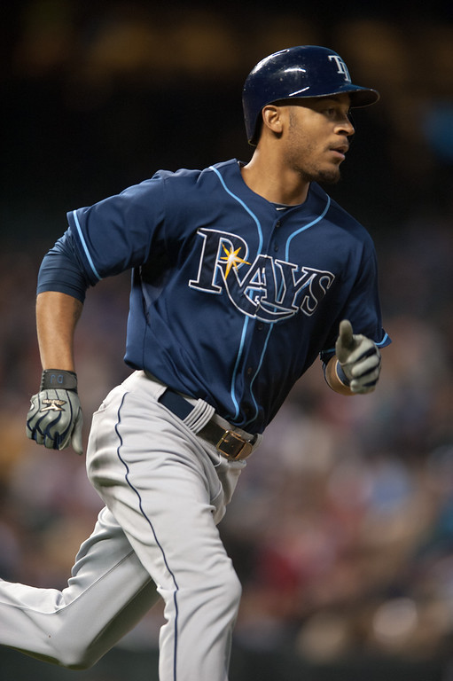 . DENVER, CO - MAY 3:  Desmond Jennings #8 of the Tampa Bay Rays circles the bases after hitting a two-run home run in the fifth inning of a game against the Colorado Rockies at Coors Field on May 3, 2013 in Denver, Colorado. The Rays led the Rockies 4-3 after four and a half innings. (Photo by Dustin Bradford/Getty Images)