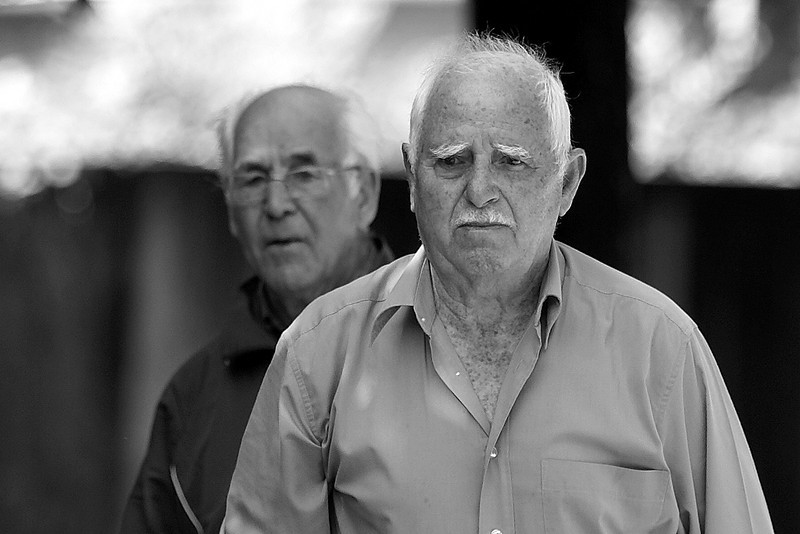 Two older men playing 'Petenque' in Bourbonne les Bains (France)