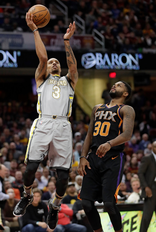. Cleveland Cavaliers\' George Hill (3) shoots against Phoenix Suns\' Troy Daniels (30) in the second half of an NBA basketball game, Friday, March 23, 2018, in Cleveland. (AP Photo/Tony Dejak)