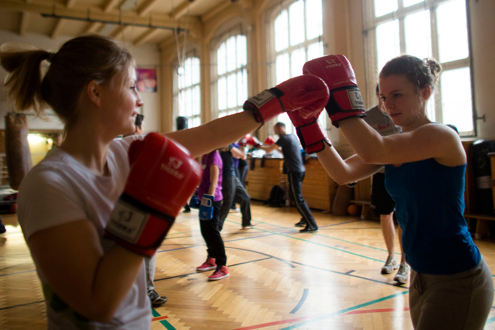 . Two women attend a boxing workshop of the Boxgirls Berlin in Berlin, Friday, March 8, 2013. The two women of the donation platform for social projects Betterplace visit the Boxgirls project to mark the International Womens Day. The Boxgirls Berlin are part of the Boxgirls International organization that supports women and girls using boxing programs as a catalyst for social change in their cities with the slogan \'Strong Girls, Save Communities\' and supporting the women and girls empowerment. (AP Photo/Markus Schreiber)