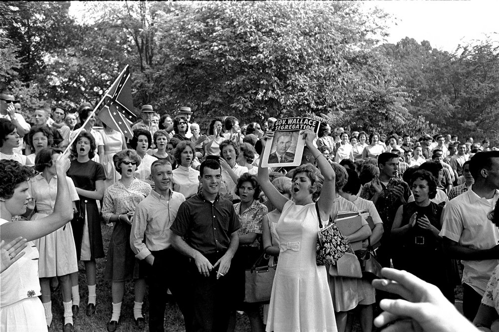 . Students at West End High yell and wave flags and a picture of Gov. George Wallace as they demonstrate in Birmingham, Ala., following admittance of two black students, September 10, 1963.  (AP Photo/stf)
