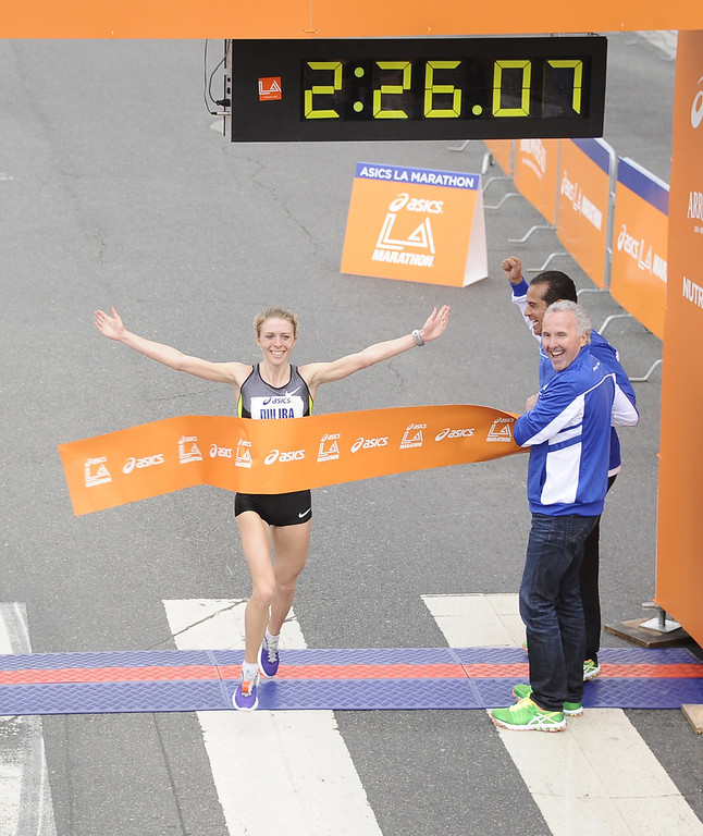 . Aleksandra Duliba, from Belarus, is the first woman to cross the finish line during the 2013 LA Marathon. Santa Monica CA. March 17,2013. Photo by Gene Blevins/ LA dailynews.