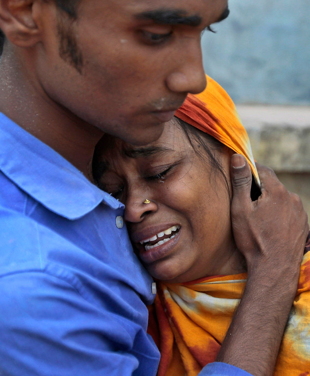 . Relatives mourn a victim at the site where an eight-story building housing several garment factories collapsed in Savar, near Dhaka, Bangladesh, Wednesday, April 24, 2013.  (AP Photo/ A.M. Ahad)