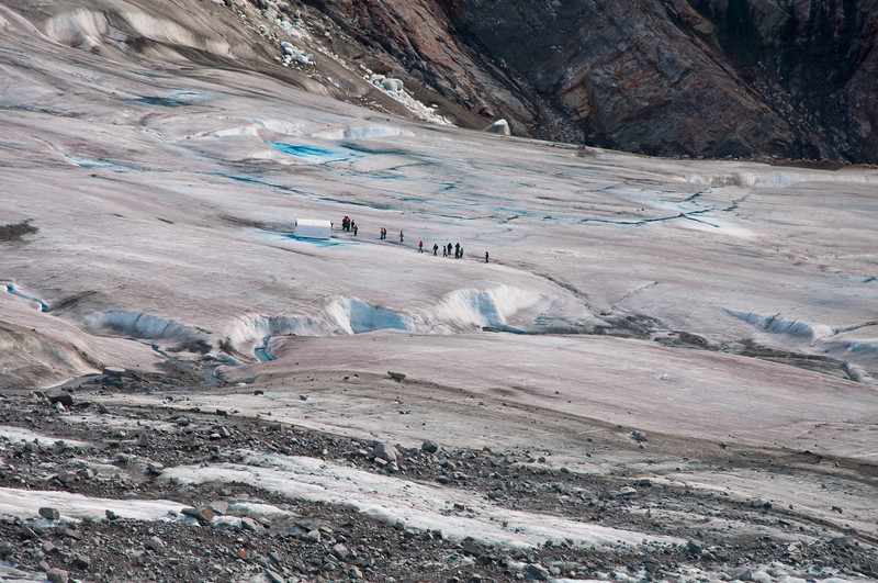 Temsco has a base on the glacier where the helicopters land and the guides stay there.
