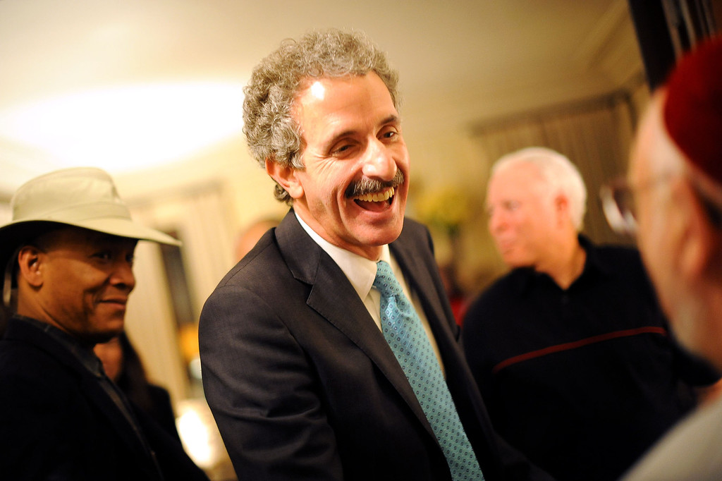 . City Attorney candidate Mike Feuer chats with guests during his election night party in Los Angeles, CA March 5, 2013.(Andy Holzman/Los Angeles Daily News)