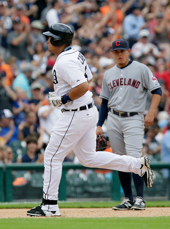 . Detroit Tigers\' Miguel Cabrera, left, rounds the bases past Cleveland Indians third baseman Giovanny Urshela after hitting a solo home run in a baseball game, Sunday, June 14, 2015, in Detroit. (AP Photo/Duane Burleson)