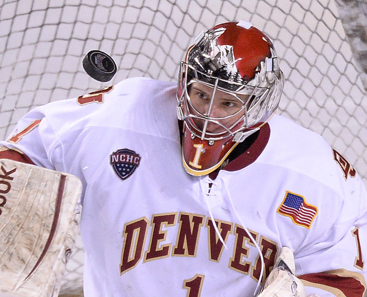 . DENVER, CO. - FEBRUARY 21, 2014: The puck bounced in front of Denver goalie Sam Brittain (1) in the third period. The Colorado College hockey team defeated Denver 3-2 at Magness Arena Friday night, February 21, 2014. Photo By Karl Gehring/The Denver Post