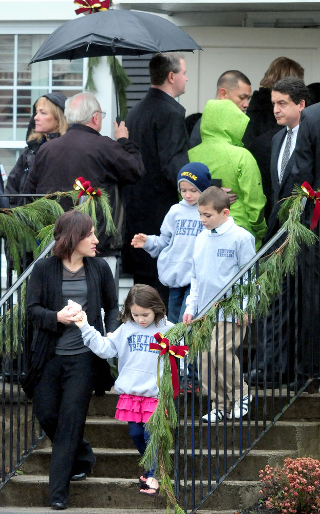 Description of . Children leave the Honan Funeral Home in Newtown on 12/17/2012 as others stand in line for funeral services for six-year-old Jack Pinto, a victim of the Sandy Hook Elementary School shootings. Photo by Arnold Gold/New Haven Register
