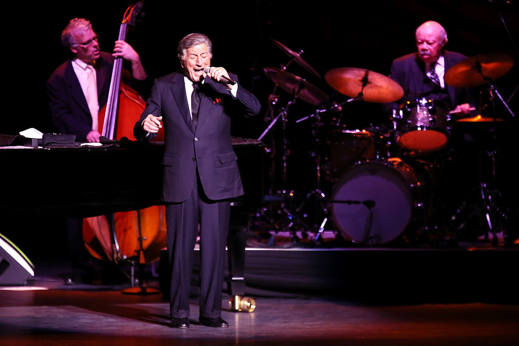 . Grammy Award singer Tony Bennett performs after receiving a standing ovation Wednesday Jan. 22, 2014 from a filled crowd at Wagner Noel in Odessa, Texas which was preceded by a performance from his daughter Antonia Bennett. Bennett performed for one show in the Permian Basin and will travel to St. Petersburg, Fl. for his next show.  (AP Photo/Odessa American, Edyta Blaszczyk)
