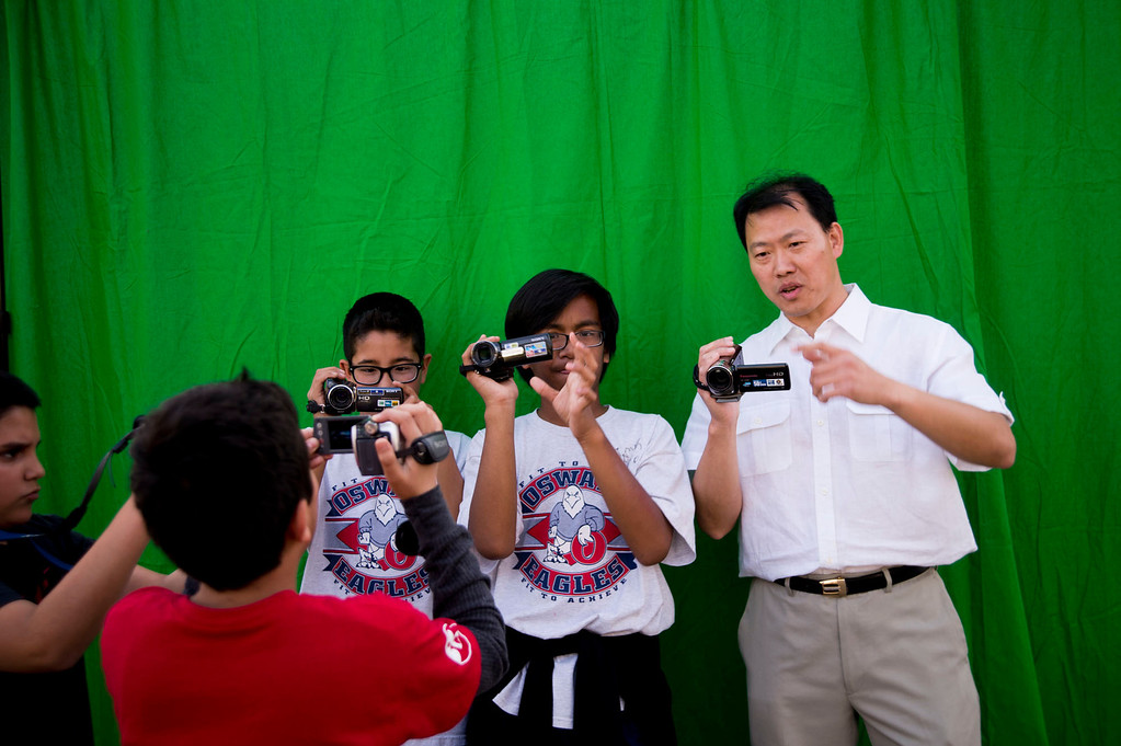. Visual Fx Artist Roger Huynh, right, teaches students how to make a commercial using a greenscreen at Oswalt Academy in Walnut on Friday, Feb. 15, 2013. Huynh has worked on �Wreck it Ralph� �BOLT� and �Lord of the Rings.\' (SGVN/Staff photo by Watchara Phomicinda)