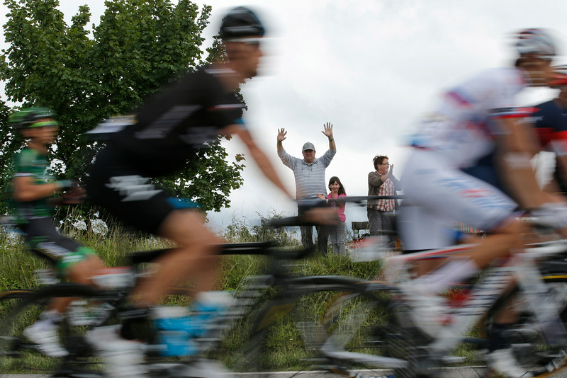 . Spectators cheer as riders pass during the eighth stage of the Tour de France cycling race over 161 kilometers (100 miles) with start in Tomblaine and finish in Gerardmer, France, Saturday, July 12, 2014. (AP Photo/Christophe Ena)