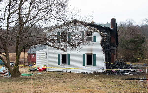 02/10/20 Wesley Bunnell | Staffrr960 East Johnson Ave. in Southington where an overnight fire occurred into the early hours of Monday morning. A side view of showing the blackened front section of the home.