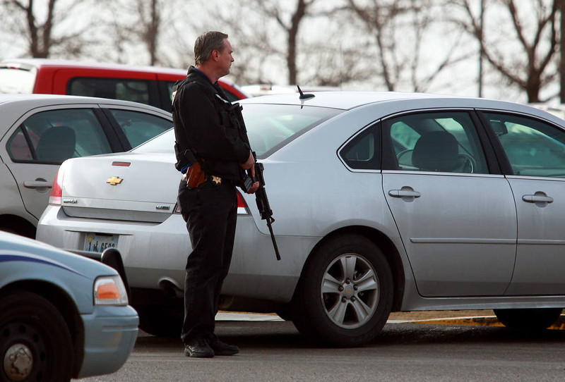 . A Natrona County Sheriff\'s deputy stands watch at the scene of a reported homicide at Casper College on Friday morning, Nov. 30, 2012, in Casper, Wyo. At least one person was killed and another was wounded Friday in an attack at Casper College, a community college in central Wyoming. It happened around 9 a.m., said school spokesman Rich Fujita.  (AP Photo/Casper Star-Tribune, Alan Rogers) TRIB.COM