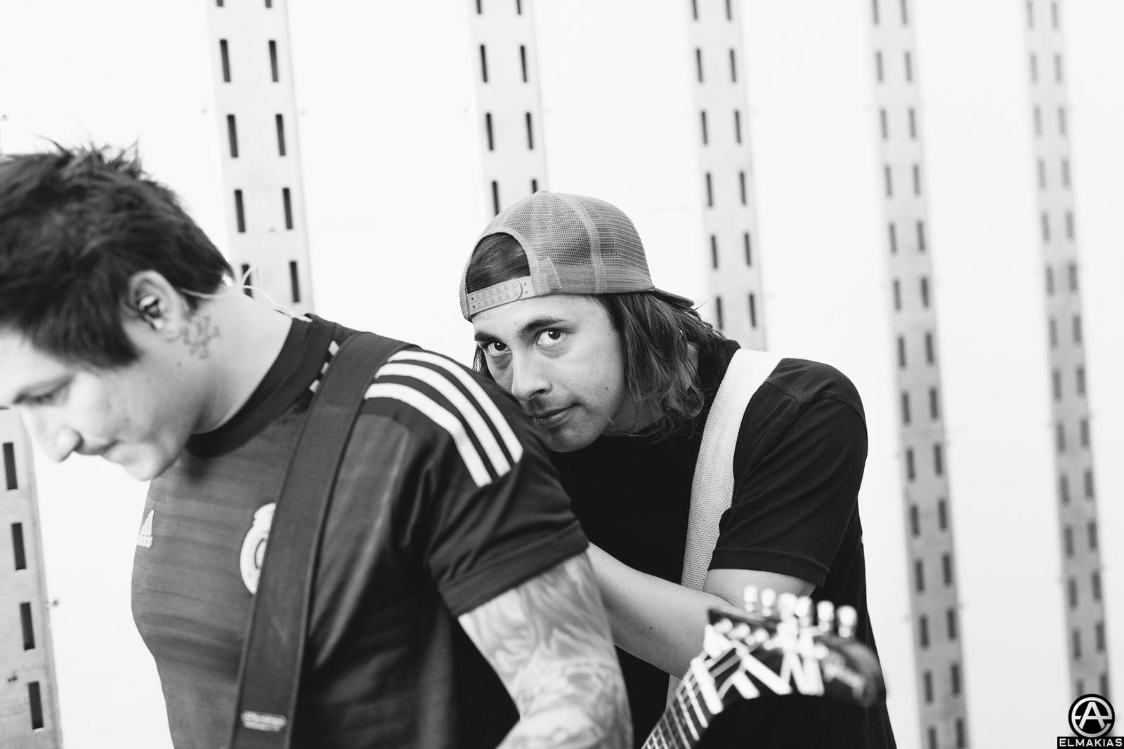 Jaime Preciado and Vic Fuentes of Pierce the Veil at Warped Tour 2015 by Adam Elmakias