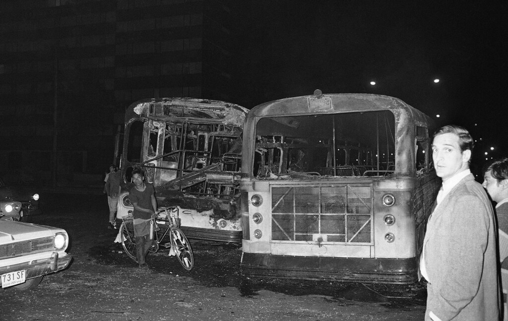 . Two burned-out buses testify to the violence of riots in Mexico City where a score or more persons were killed and many others wounded in the worst outbreak of student disorders since they began several months ago, Oct. 3, 1968. (AP Photo)