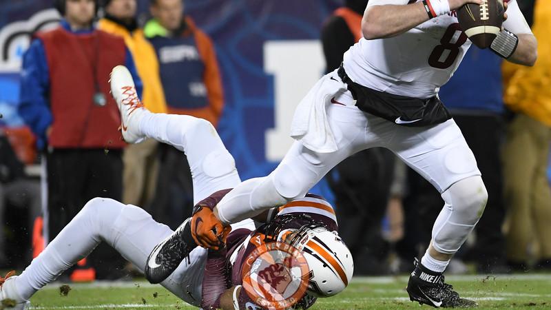 Virginia Tech safety Mook Reynolds (6) grabs and brings down Arkansas quarterback Austin Allen (8). (Michael Shroyer/ TheKeyPlay.com)
