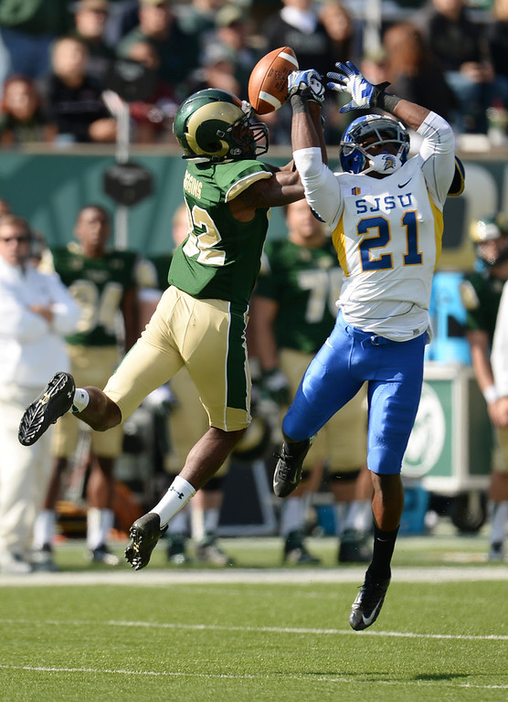 . FORT COLLINS, CO - OCTOBER 12 : Bene Benwikere of San Jose State (21), right, breaks a catch for Rashard Higgins of Colorado State (82) in the 2nd quarter of the game at Hughes Stadium. Fort Collins. Colorado. October 12, 2013. San Jose won 34-27. (Photo by Hyoung Chang/The Denver Post)