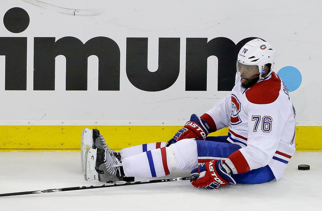 . Montreal Canadiens defenseman P.K. Subban (76) sits on the ice after being upended during the first period against the New York Rangers in Game 6 of the NHL hockey Stanley Cup playoffs Eastern Conference finals, Thursday, May 29, 2014, in New York. (AP Photo/Frank Franklin II)
